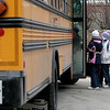 Gloucester:  Students from East Gloucester Elementary School board their bus at the end of the school day Thursday. The Gloucester school administration is proposing that bus students K-8 be charged $250 a year if they live less than two miles from their school. Mary Muckenhoupt/Gloucester Daily Times