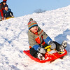 Gloucester: Neville Clancy, 5, speeds down the hill near Sam Parisi Field at Stage Fort Park on Wednesday afternoon as his mom, Kathy Clancy, gives Jacob Andrews, 4, a push. Photo by Kate Glass/Gloucester Daily Times Wednesday, February 4, 2009