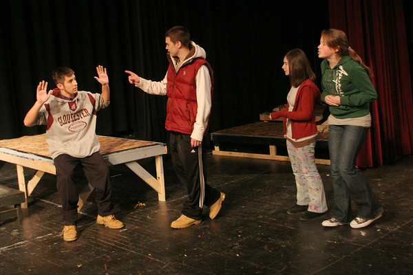 Gloucester: From left, Gloucester freshman Kyle Lucido , Coltyn Rivas, Nicole Dahlmer and Laura Spilman perform a skit to raise awareness on the dangers of using prescription drugs in the high school auditorium Friday morning. The skits are being taped and will be posted on School Tube for kids to vote on which skit they think is the best.  Gloucester was one of ten communities to receive a one year grant from the Massachusetts Attorney Generals Office for drug prevention allowing over 200 Gloucester High School students to become involved in raising awareness of the dangers of abusing prescription drugs. Mary Muckenhoupt/Gloucester Daily Times