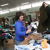 Manchester: Bernice Hannigan of Rockport takes a vest that was handed to her while perusing the clothing tables at the rummage sale in the cafeteria of the Manchester Essex High School Saturday. The sale, which included bicycles, skis, furniture and more, was a fundraiser for the Class of 2010. Mary Muckenhoupt/Gloucester Daily Times