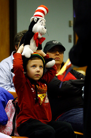 Gloucester: Cameron Dempsey holds the Cat in the Hat on his head as he listens to Carole Finn talk about the life of Dr. Seuss at the Sawyer Free Library on Saturday. Photo by Kate Glass/Gloucester Daily Times Saturday, February 21, 2009