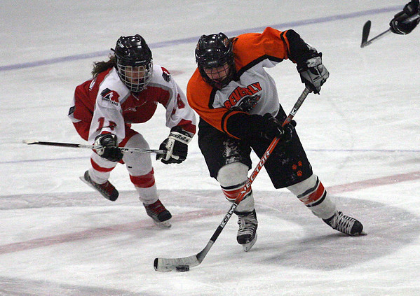 Beverly's Emily Interrante of Gloucester steals the puck from Masconomet's Jen Pino during their 3-3 tie at the Talbot Rink last night. Photo by Kate Glass/Gloucester Daily Times Monday, February 2, 2009