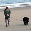 Rockport: Steve Thomas of Rockport walks his dog Missy on Front Beach Saturday afternoon.  Missy is a Newfoundland and has no problem keeping warm in the winter with her thick coat. Mary Muckenhoupt/Gloucester Daily Times