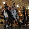 Manchester: Manchester Essex's Zeke Gillette tries to steal the ball from Trinity Catholic's Jeff Pascal during the first round of the Division 4 North State Tournament at Manchester Essex High School last night. Photo by Desi Smith/Gloucester Daily Times Tuesday, February 24, 2009