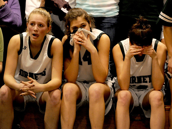 Manchester: Manchester-Essex's Julia Martz, Hannah Dumont and Jen Bishop watch as the seconds tick off the clock and their season comes to an end against Matignon High School Saturday night at Manchester-Essex Regional High School.<br /> Photo by Desi Smith/Gloucester Daily Times Sunday, March 01, 2009
