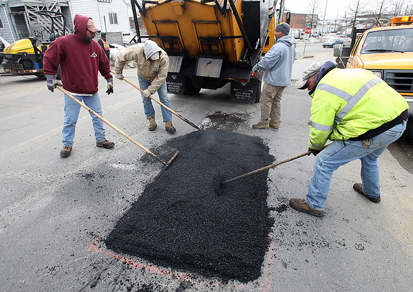 Gloucester: Bill Gilliss, Joe Silva, Scott Amero and Steve Peters spread asphalt across a pothole on Eastern Ave yesterday afternoon. The crew also repaired a large section of Main Street earlier in the day. Photo by Kate Glass/Gloucester Daily Times Tuesday, February 10, 2009
