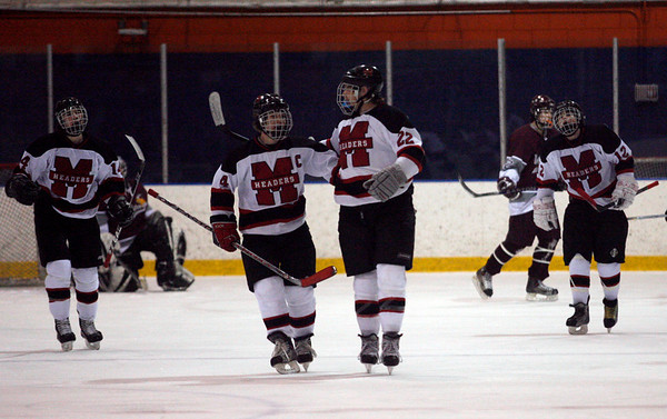 Salem: Marblehead's Anders Gunderson congratulates teammate Ben Koopman after he scored the first goal against Rockport during the first round of the Division 3 North tournament at Salem State last night. Photo by Kate Glass/Salem News Thursday, February 26, 2009