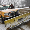 Gloucester: Scott Amero scrapes ice from his windshield wipers while waiting for sand at the Gloucester DPW yesterday afternoon. Photo by Kate Glass/Gloucester Daily Times Tuesday, February 3, 2009