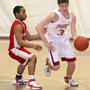 Gloucester: Gloucester's Chris Peritore dribbles past Amesbury's Stephan Deas during the basketball game held at Benjamin A. Smith Fieldhouse Wednesday night. Mary Muckenhoupt/Gloucester Daily Times