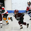 Gloucester: Jayden Kamm of the Cape Ann mites skates down the ice while playing against a team from Westmount, Quebec during the Sal Grasso Friendship Tournament at Dorothy Talbot Rink Saturday afternoon.  The Mites, ages 6 to 8, were the first to play Saturday followed by squirt, peewee and bantam players.  Mary Muckenhoupt/Gloucester Daily Times