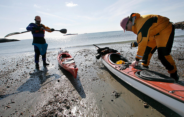 Manchester: Sid Cohen of Billerica, left, and Ross Bartosik of Amesbury prepare for an afternoon of kayaking at White Beach in Manchester yesterday. The two had dry suits in case they tipped over, but the flat water was inviting enough to forget the temperature. Photo by Kate Glass/Gloucester Daily Times Tuesday, February 17, 2009