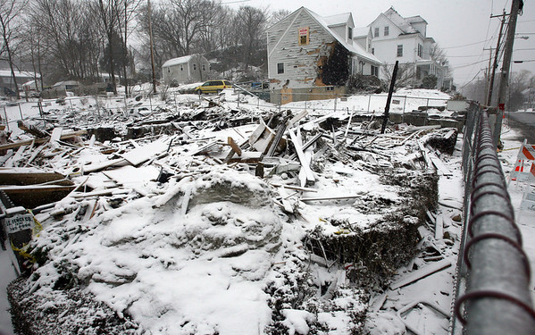 Gloucester: A cleaning crew removes items from 78 Eastern Ave. (rear) following last Sunday's explosion at 76 Eastern Ave (front). A portion of 78 Eastern Ave. will have to be rebuilt. Photo by Kate Glass/Gloucester Daily Times Tuesday, February 3, 2009