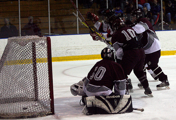 Salem: Marblehead's Ellery Smith raises his arms as he watches the puck slip behind Rockport goalie Nile Halvorson during the first round of the Division 3 North tournament at Salem State last night. Photo by Kate Glass/Salem News Thursday, February 26, 2009