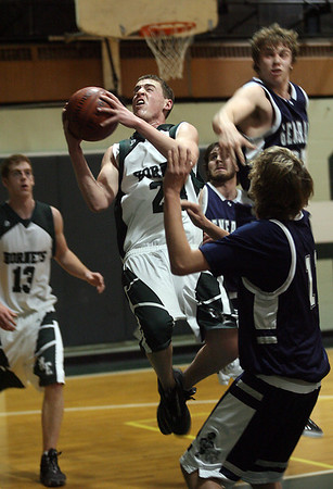 Manchester: Manchester Essex's Willie Baun drives toward the net during their game against Hamilton-Wenham last night. Photo by Kate Glass/Gloucester Daily Times Tuesday, February 3, 2009