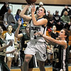 Manchester:  M/E Lizzy Ball goes in for a lay against North Reading's last night at M/E High School..Photo by Desi Smith/Gloucester Daily Times Tuesday, January 09, 2009