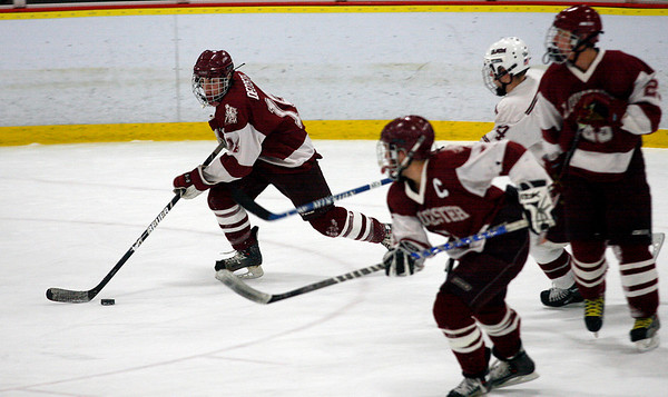 Gloucester's Nick Decoste clears the puck from the defensive zone during their game against Arlington at Veterans Memorial Rink last night. Photo by Kate Glass/Gloucester Daily Times Wednesday, February 18, 2009