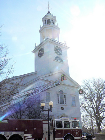 Manchester firefighters remove the Christmas wreaths from Town Hall yesterday afternoon. Photo by Robert Cann/Gloucester Daily Times Tuesday, February 17, 2009