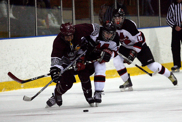 Salem: Rockport's Pat Hofmann and Marblehead's Chris Mcleod battle for the puck during the first round of the Division 3 North tournament at Salem State last night. Photo by Kate Glass/Gloucester Daily Times Thursday, February 26, 2009