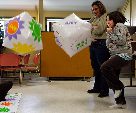Gloucester: Vicki Basso, 9, throws oversized dice to determine the next move in an oversized game of Twister at the Wellspring Cape Ann Families building. The organization offered several games to entertain the kids while they are on school vacation. Photo by Kate Glass/Gloucester Daily Times Tuesday, February 17, 2009