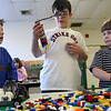 Rockport: Gillis Malcomson, 6, left, and John Paul Penaloza, 6, right, look at Gaetano Micalizzi's LEGO creation during an after school program at Rockport Elementary School on Monday. All the finished works are featured in a display case in the school. Photo by Kate Glass/Gloucester Daily Times Monday, February 9, 2009