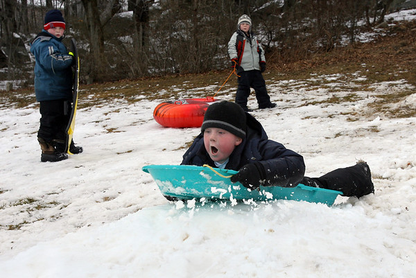 Rockport: Daniel O'Leary screams as he goes over a jump at Evans Field while his friends, Paul Larrabee, left, and Austin Waalewyn, right, watch on Wednesday afternoon. Photo by Kate Glass/Gloucester Daily Times
