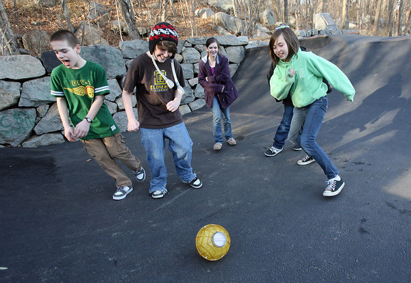 "Rockport: Dan Robichaud, Charlie Larsen, Maddie Ryan, and Kailee Ruphard kick around an ice cream maker at the Matt Waddell Skate Park behind the YMCA Ben Beyea Youth and Teen Center as they make ""Teen Center Twist"" ice cream with cake batter, gummie bears, and skittles yesterday afternoon. Photo by Kate Glass/Gloucester Daily Times"