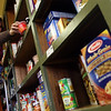 Gloucester: Lauren Gudonis stocks the shelves at the Cape Ann Open Door Food Pantry yesterday afternoon. The non-profit purchased the Emerson Ave. building it has been renting from Wellspring, Inc. Photo by Kate Glass/Gloucester Daily Times