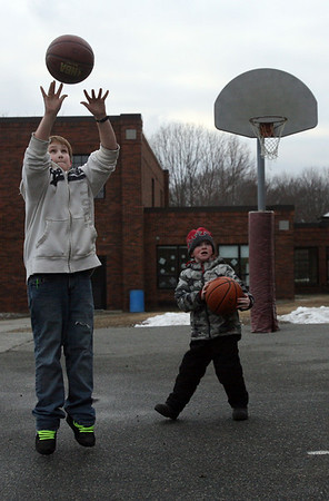 Rockport: Dustin Karalfa, 12, and Roy Gebhardt, 5, play basketball outside Rockport Elementary School during the YMCA's after school program on Wednesday. Photo by Kate Glass/Gloucester Daily Times