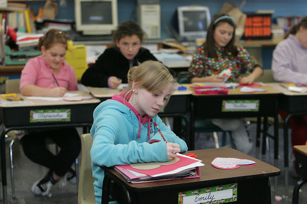"Gloucester: Emily Stuart works on her Valentine's Day card in Elaine Engemann's forth grade class at Verternas Elementary School Thursday afternoon. The students were making Valentines called ""Bravehearts"" to send to troops overseas. Sarah Van Auken, whose daughter was in Iraq in 2003, collects the valentines and ships them to the troops. Students at elementary schools throughout Gloucester have been participating in the project.  Mary Mucenhoupt/Gloucester Daily Times"