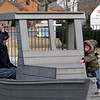 Gloucester: Stephen Crumpacker plays peekaboo with his son, Sean Patrick Crumpacker, on the boat at Rebecca's Playground on Monday. Photo by Kate Glass/Gloucester Daily Times
