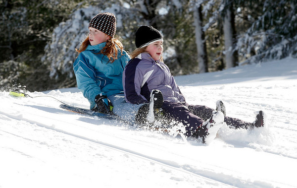 Manchester: Molly Field, 8, and Elizabeth Athanas, 7, go sledding at Essex County Club on Wednesday morning. Photo by Kate Glass/Gloucester Daily Times