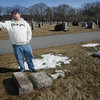Gloucester: Matt Eastman points over to how near his granmother's grave sight is to some knocked over gravestones that he has noticed at Calvary Cemetery Friday afternoon. Mary Muckenhoupt/Gloucester Daily Times