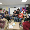Gloucester: From left, Kyarrah Jean-Simon, Jamie Frontiero, Noah Ashe, getting help from teacher Pat Hand, Jade Barry, Tiki Dennie and Danielle Thibodeau work on knitting dolls to send down to haiti in Heidi McGrath's classroom after school Monday at O'Maley Middle School. The knitting pattern is on the school's website so anyone can knit a doll or just knit the pattern and someone will make the knitting into a doll for them. Mary Muckenhoupt/Gloucester Daily Times