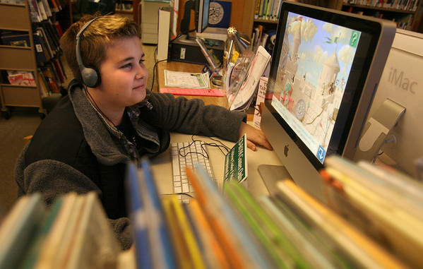"Manchester: Joey Cirone of Manchester plays ""I Spy"" at the Manchester Public Library yesterday afternoon. The game lists different items for people to find in a variety of scenes. Photo by Kate Glass/Gloucester Daily Times"