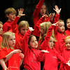 Manchester: Memebers of La Petite Chorale sing for Haiti at a fundraising concert held at Manchester Memorial Elementary School Monday evening. Mary Muckenhoupt/Gloucester Daily Times