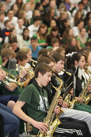 Gloucester: Freshman Nate Graves plays the saxaphone with the Manchester Essex Regional High School during the winter sports pep rally at the high school gymnasium Friday afternoon. Mary Muckenhoupt/Gloucester Daily Times