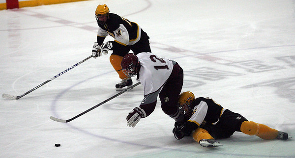 Stoneham: Rockport's Scott Greene draws a tripping penalty from Latin Academy's Thomas Hynes in the third period as he skates on a breakaway during the first round of the MIAA Division 3 North Tournament at the Stoneham Arena last night. Rockport won 3-2. Photo by Kate Glass/Gloucester Daily Times