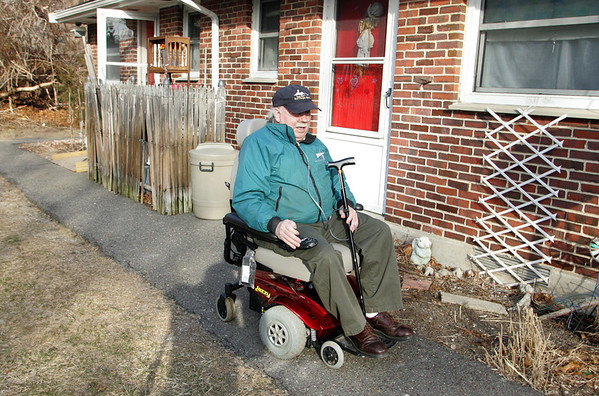 Gloucester: Harold Roberts leaves his Poplar Park home in the motorized wheelchair that had been stolen Thursday and returned to him Friday after high school students found chair and returned it.  Mary Muckenhoupt/Gloucester Daily Times
