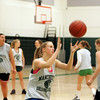 Manchester: Manchester Essex senior Grace Gillette catches a rebound while running drills at basketball practice at Manchester Essex Regional High School Thursday afternoon. The girls are getting ready for their tournamnet game Saturday night in Lexington. Mary Muckenhoupt/Gloucester Daily Times