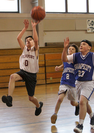 Rockport: Paul Fears Shoots past Swampscott defenders C.J. Howard and Matt Hubauer, right, during a sixth grade youth basketball game at Rockport High School Saturday afternoon. Mary Muckenhoupt/Gloucester Daily Times