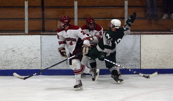 Gloucester: Gloucester's Vinny Terranova knocks Dennis-Yarmouth's Alex Dockham down on the ice as Sal Taormina skates by during the Fishermen's 9-1 win at the Talbot Rink last night. Photo by Kate Glass/Gloucester Daily Times