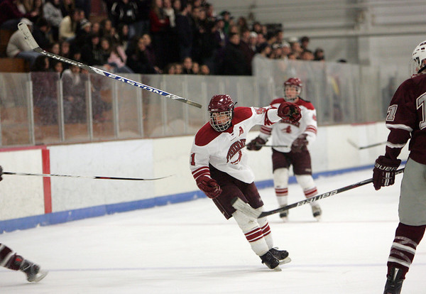 Gloucester: Gloucester's MacKenzie Quinn looses his stick during the hockey game against Arlington at Dorothy Talbot Rink Wednesday night. Mary Muckenhoupt/Gloucester Daily Times