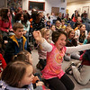 Rockport: Abbie Engel, 9, cheers with the crowd during the Secret World of Bubbles presentation at the Rockport Public Library Saturday morning. Mary Muckenhoupt/Gloucester Daily Times