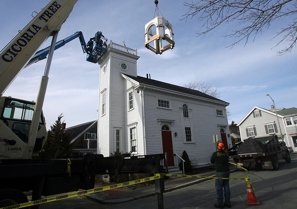 Manchester: Seaside No. 1's hose tower is hoisted off the building yesterday afternoon so it can be restored by Stan Magnuson & Associates. Photo by Kate Glass/Gloucester Daily Times