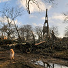 Gloucester: Courtney Richarson looks at the damage at Oak Grove Cemetary after a high winds knocked down trees and tree limbs in the cemetery Friday morning. Desi Smith/Gloucester Daily Times