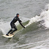 Rockport: Nick Drayer of Rockport catches a wave while surfing with his friend Adam MacDowell at Back Beach Saturday morning.  Mary Muckenhoupt/Gloucester Daily Times