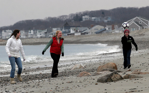 Rockport: Whitney Callahan, Hannah Brunelle, and Riley Fennessy kick a soccer ball up and down Cape Hedge Beach yesterday afternoon. The three said they needed to blow off a little steam after school. Photo by Kate Glass/Gloucester Daily Times