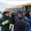 Gloucester: Graham Walker of Rockport looks for any last minute bird sightings with his wife Jan after deboarding a bus that took them around Rockport and Gloucester to view birds as part of the Cape Ann Winter Birding Weekend sponsored by the Cape Ann Chamber of Commerce Saturday. The weekend included guided field trips, expert speakers and demonstrations at the Gloucester Elks Club and a boat trip out to Stellwagen Bank. Mary Muckenhoupt/Gloucester Daily Times