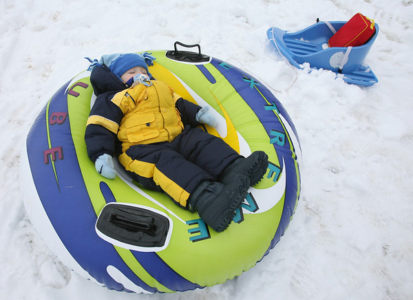 Rockport: Flynn Blanchard, 16 months, sleeps in a snow tube while out playing at Evans Field with his family on Wednesday. Photo by Kate Glass/Gloucester Daily Times