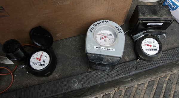 Rockport: The new meter, left, replaces two types of old meters, right, which used telephone lines to transmit consumption data. Photo by Kate Glass/Gloucester Daily Times